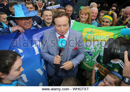 Dublin, Ireland September 1, 2019. RTE reporter Marty Morrissey with supporters of Dublin and Kerry at Croke Park in Dublin before an exciting All Ireland final game, which ended in a draw. The two teams will return on Saturday week with Dublin's hopes of five titles in a row still alive. - Stock Photo