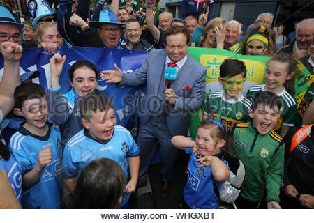 Dublin, Ireland September 1, 2019. RTE reporter Marty Morrissey with supporters of Dublin and Kerry at Croke Park in Dublin yesterday before an exciting All Ireland final game, which ended in a draw. The two teams will return on Saturday week with Dublin's hopes of five titles in a row still alive. - Stock Photo