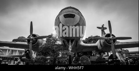 Crashed military propeller aircraft of US air force as symbol for victory in American War at war museum in Hanoi, Vietnam - Stock Photo
