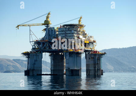 Rio de Janeiro, Brazil, August 4, 2013: Petrobras Petroleum Platform P61 TLWP (Tension Leg Wellhead Platform)  being transferred to the Campos product - Stock Photo