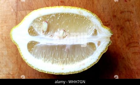 Close-up Of Halved Lemon On Table - Stock Photo