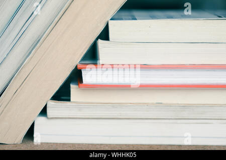 A large number of old books stacked on top of each other. Background shot, clean blank copy space - Stock Photo