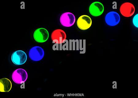 Close-up Of Illuminated Colorful Led Lights Against Black Background - Stock Photo