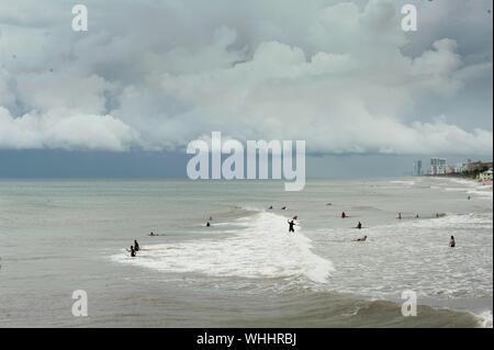 Dania Beach, Florida, USA. 2nd Sep, 2019. Surfers enjoy the waves at Dania Beach, FL, as wind picks up with Hurricane Dorian approaching the coast of Florida. Credit: Orit Ben-Ezzer/ZUMA Wire/Alamy Live News - Stock Photo