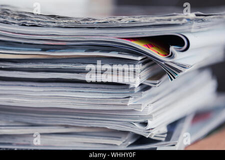 A stack of magazines, close-up macro filled the frame. A background for publishing or informational articles. - Stock Photo