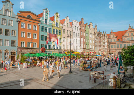 Tourists and locals shopping and sightseeing in the historic old town of the port city of Gdansk in Poland - Stock Photo