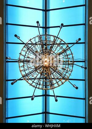Directly Below View Of Illuminated Chandelier - Stock Photo