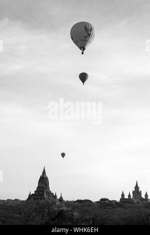 BAGAN, MYANMAR - 06 DECEMBER, 2018: Black and white picture of hot air balloons over the amazing ancient temples in Bagan, Myanmar - Stock Photo