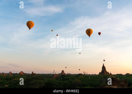 BAGAN, MYANMAR - 06 DECEMBER, 2018: Horizontal picture of hot air balloons over the old temples in Bagan, Myanmar - Stock Photo