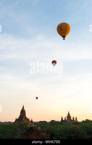 BAGAN, MYANMAR - 06 DECEMBER, 2018: Vertical picture of hot air balloons over the old temples in Bagan, Myanmar - Stock Photo