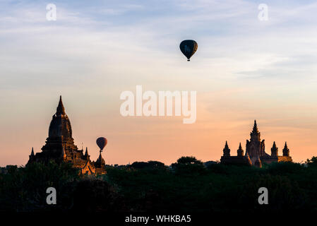 BAGAN, MYANMAR - 06 DECEMBER, 2018: Horizontal picture of colorful sky with amazing architecture buddhist temples in Bagan, located in Myanmar - Stock Photo