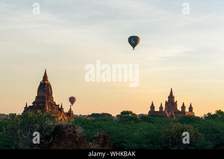 BAGAN, MYANMAR - 06 DECEMBER, 2018: Wide angle picture of colorful sky with amazing architecture buddhist temples in Bagan, located in Myanmar - Stock Photo