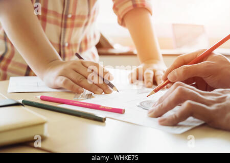 Engineer teamwork sketching a housing project. - Stock Photo