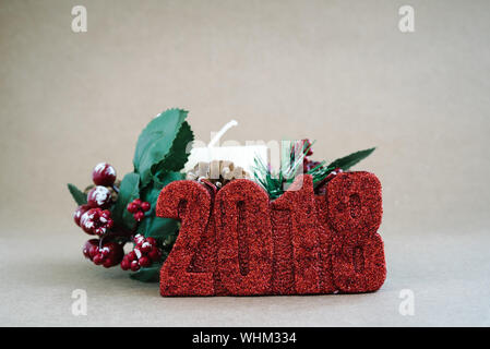 Close-up Of Christmas Decorations Against Gray Background - Stock Photo