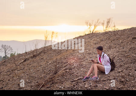 Woman sitting on the hill,Sitting on the hill.