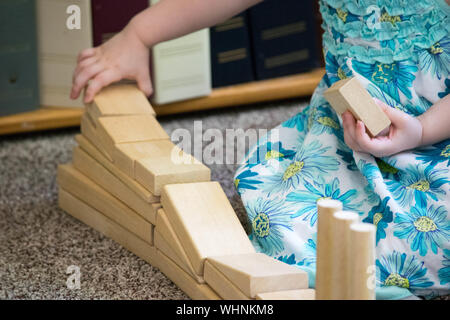 Midsection Of Girl Stacking Wooden Toy Blocks - Stock Photo