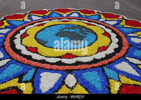 flower petals, grains, rice, beans and seeds showing the Earth at Castelraimondo's flower festival in Italy for Corpus Christi made by the local WWF - Stock Photo