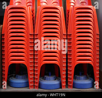 Stack Of Red Chairs - Stock Photo