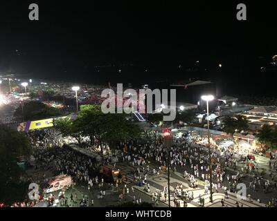 High Angle View Of Crowd Gathered On Street At Night - Stock Photo