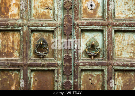 Close-up view of an old decorated wooden door in Jodhpur, Rajasthan, India. Jodhpur is the second-largest city in the Indian state of Rajasthan, India - Stock Photo