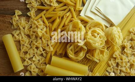 High Angle View Of Various Dried Pasta - Stock Photo