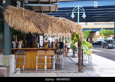 Milwaukee, WI USA. Jul 2018. The Historic Third Ward and Outdoor Market with tourists eating, shopping, and just relaxing with a good drink. - Stock Photo