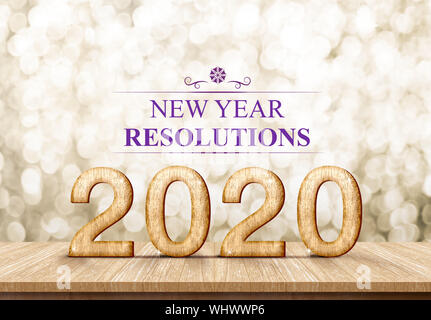 2020 happy new year rosolutions (3d rendering) on wood table with sparkling gold bokeh wall,leave space for display or montage of design or content - Stock Photo