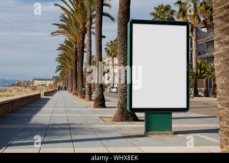 Blank billboard mock up in the street, next to the sea - Stock Photo
