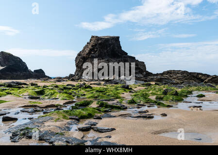 porthcothan beach at low tide, looking west and shot from a low angle. - Stock Photo