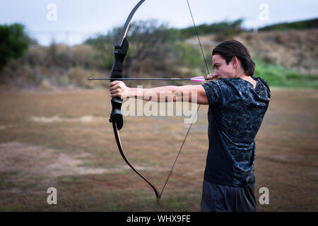 Focusing on the bull's eye. Steady pulling on the arrow. Aiming on your goals.