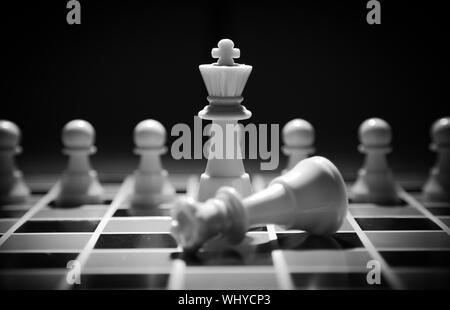 Chess Pieces On Board Against Black Background