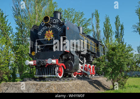 Old Soviet locomotive from the Second World War. The inscription says - USSR and forward to the west - Stock Photo