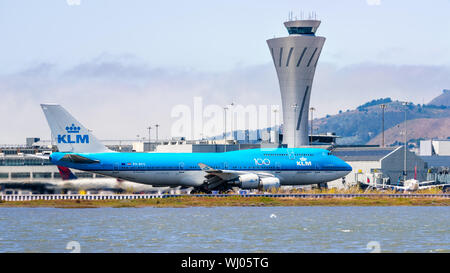 September 1, 2019 Burlingame / CA / USA - KLM aircraft preparing for take off at San Francisco International Airport (SFO); Traffic control tower visi - Stock Photo