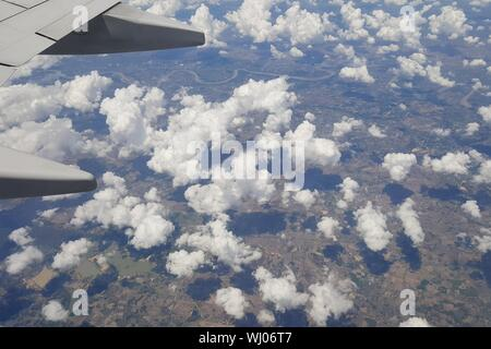 Aerial View Of Airplane Wing Over Clouds - Stock Photo