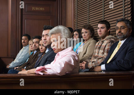 Jurors sitting  in courtroom - Stock Photo