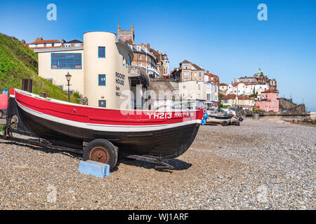 30 June 2019: Cromer, Norfolk, UK - The beach at Cromer, Norfolk, with boats on trailer and the RNLI Museum. - Stock Photo