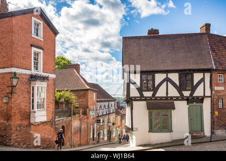 2 July 2019: Lincoln, UK - Tourists near the top of Steep Hill, Lincoln, UK, on a beautiful summer day. - Stock Photo