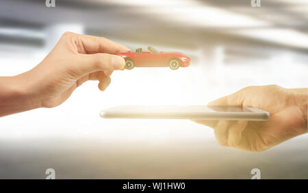 Using digital tablet in a hand palm - Stock Photo