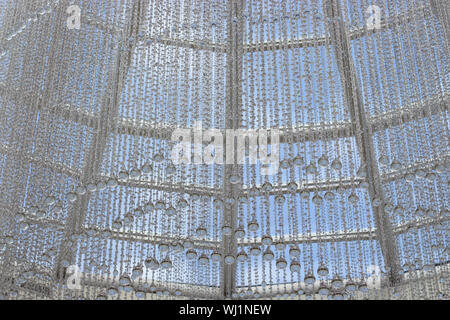 Glass decoration bead garland with large drops. Interior design, transparent beads with festive decoration. Background Wallpaper - Stock Photo