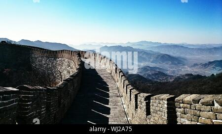 Great Wall Of China Against Sky On Sunny Day - Stock Photo