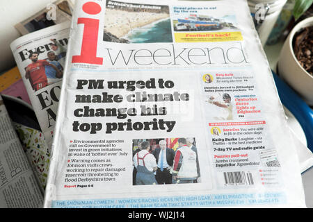 Boris Johnson 'PM urged to make climate change his top priority' front page i weekend newspaper headline 3 - 4 August 2019 London England UK - Stock Photo