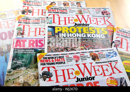 The Week Junior selection of weekly magazines front covers and magazine 'Protests in Hong Kong' laid out on a table London England UK 2019 - Stock Photo