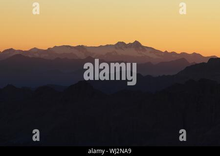 Grossglockner (Austria) seen from Marmolada Summit  Italy  Dolomites - Stock Photo