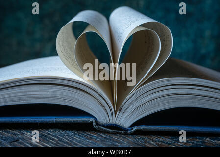 Close-up Of Pages Folded In Heart Shape - Stock Photo