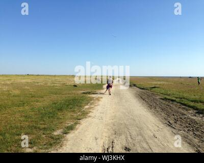 Father And Son On Dirt Road - Stock Photo