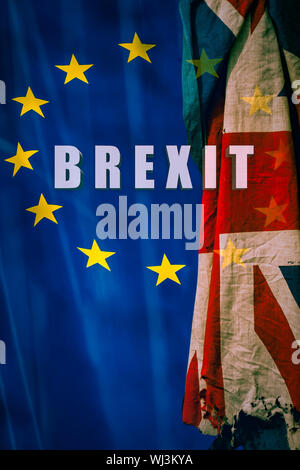 Brexit Written in Bold Text on Background With Flag of European Union and Ripped Up United Kingdom Flag - Stock Photo