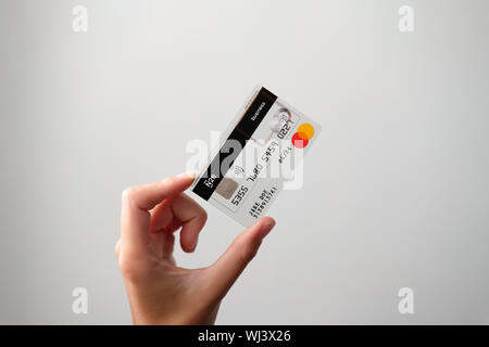 N26 transparent business creditcard held tilted by female hand - Stock Photo