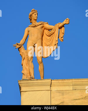 Greek God of the Sun Apollo also god of music, truth and prophesy, with python on a tree trunk. Ancient greek statue by Leochares - Stock Photo