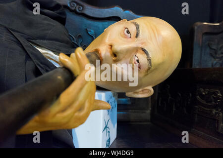 An exhibit showing Chinese opium smoking at the Hakka Tin Miners Club Museum shophouse in Ipoh, Malaysia. - Stock Photo