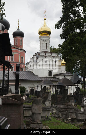 Small Cathedral (Old Cathedral) of the Donskoy Monastery and the monastery cemetery in Moscow, Russia. The Great Cathedral (New Cathedral) is seen at the left. - Stock Photo